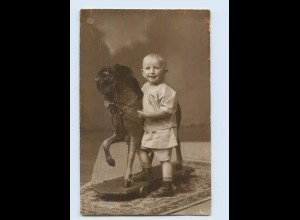 K141/ Kind mit Spielzeugpferd Foto AK ca.1925