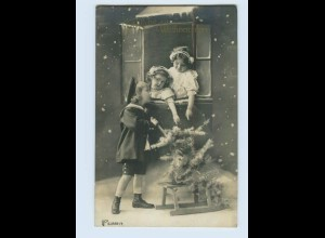 K619/ Weihnachten Kinder mit Tannenbaum Foto AK 1911