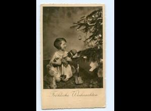 Y9007/ Weihnachten Mädchen mit Puppe Spielzeug AK 1934