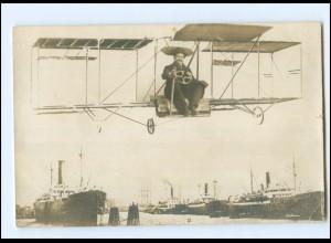 XX002190/ Fotomontage Foto AK Mann im Flugzeug Hafen Schiffe ca. 1920