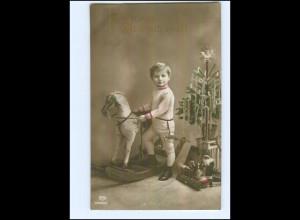 U6572/ Weihnachten Junge mit Schaukelpferd, Spielzeug Foto AK 1914