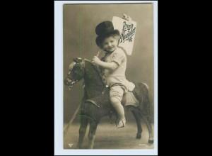 W3M47/ Kind Spielzeugpferd Holzpferd Foto AK 1910